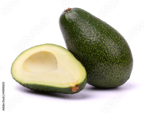 Ripe cut avocado isolated on white background