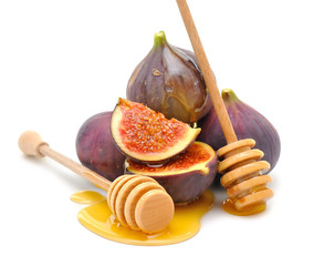 Figs with honey on white background