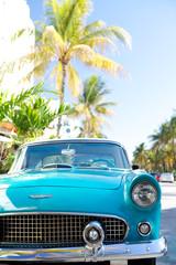 Vintage car in ocean drive