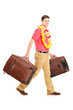 Young male walking with his luggage
