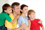 Pleasant family in bright T-shirts poster