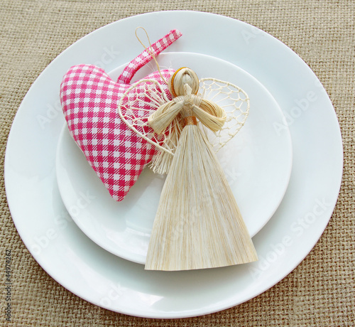 Romantic serving of festive table with a handmade decoration ang