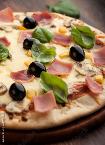 Pizza with mushrooms, ham and olives