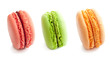 line of three delicious french macaron cookies isolated on white