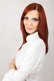 Beautiful red-haired business woman in white shirt