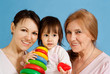 A beautiful Caucasian baby with her mother and grandmother