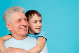 Caucasian aged man with a youngster poster