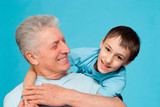 Caucasian elderly man with a youngster poster
