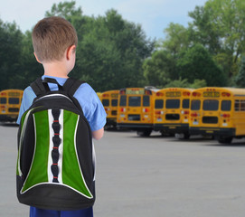 School Boy Looking at Bus with Bookbag