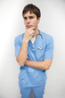 Male nurse is thinking with chin in hand
