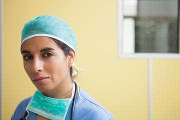 Woman wearing scrubs in hospital room