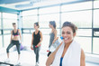Woman with bottle of water in aerobics class