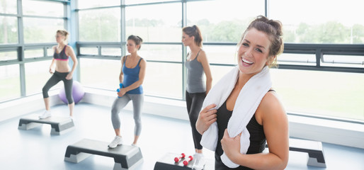 Happy woman taking a break at aerobics class