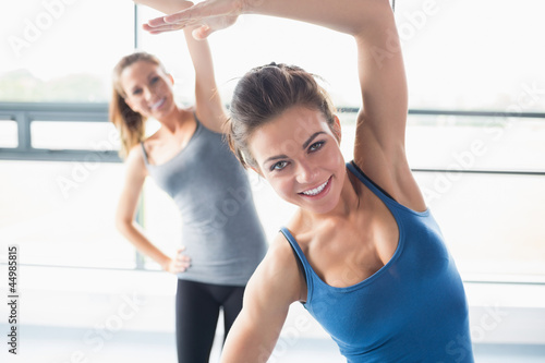 Women stretching their arms