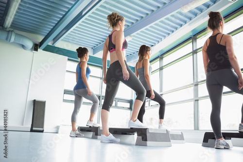 Four women at aerobics