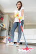 Brunette woman mopping the floor