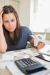 Young woman feeling financial pressure