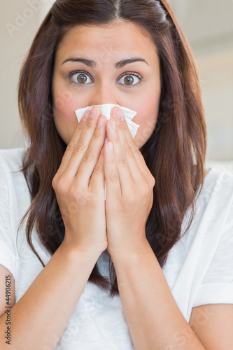 Brunette with runny nose