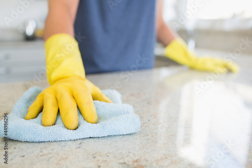 Woman cleaning the counter Poster