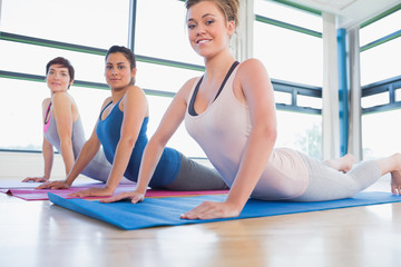 Smiling women at yoga class