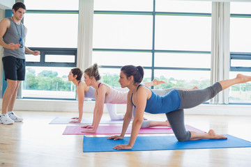 Male instructor with yoga class