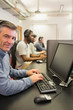 Smiling man in computer class