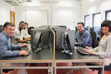 Happy group in a computer room
