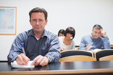 Man looking up from class