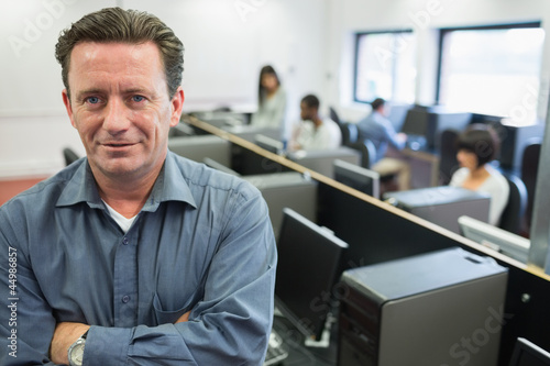 Man smiling at front of computer class