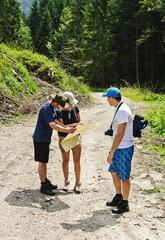 Hikers looking at map