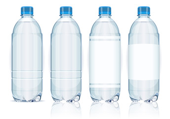 Four plastic bottles with labels.ì
