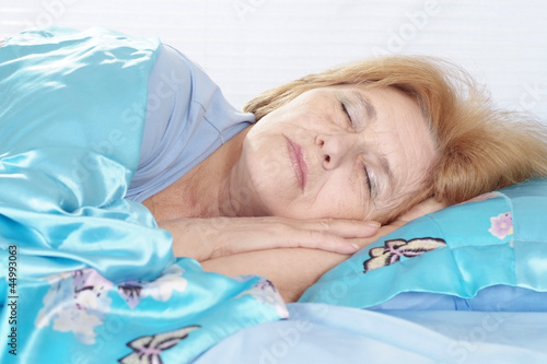 Sleeping woman is resting at home