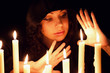Young beautiful soothsayer with candles