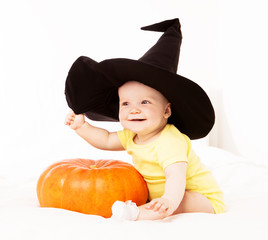 baby with a pumpkin