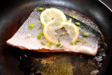 Frying Salmon with Fresh Lemon Slices, Lemon Juice and Scallions