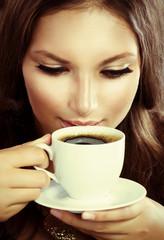 Beautiful Girl Drinking Coffee or Tea