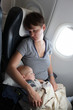 Mother with baby at airplane