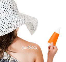 Summer woman wearing sunblock
