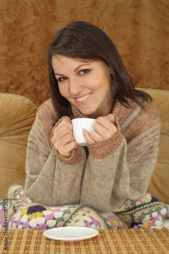 Good Caucasian woman on a sofa