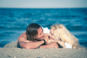 Couple in love relaxing at the beach.