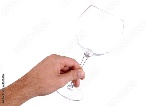 hand holds a wine glass, isolated on white
