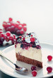 Delicious cheesecake with grapes and forest fruits