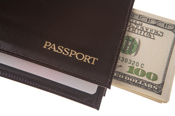 pack of US dollares out into passport