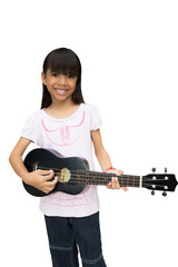 Beautiful little girl playing guitar