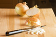 Sliced onions on cutting board