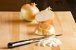 Sliced onions on cutting board