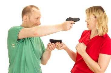 A man hold a woman at gunpoint
