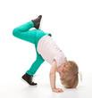 Active little girl doing sport exercises