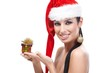 Sexy woman in santa hat holding Christmas box