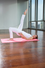Young Woman Practicing Yoga On Mat